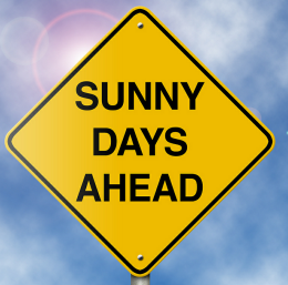 sign with the words sunny days ahead